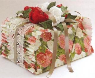 Kā skaisti iepakot neregulāras formas dāvanu