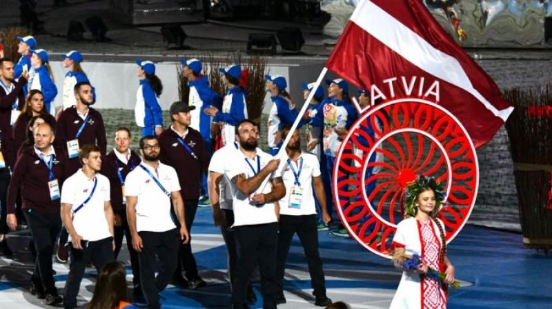 Eiropas spēļu atklāšanā Jevgeņijs Borodavko nes Latvijas karogu. Foto: Mārtiņš Mālmeisters, Latvijas Olimpiskā komiteja