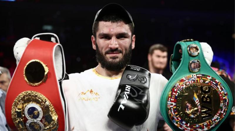 Artūrs Beterbijevs ar IBF un WBC čempiona jostām. Foto: Valery Sharifulin/TASS/Scanpix