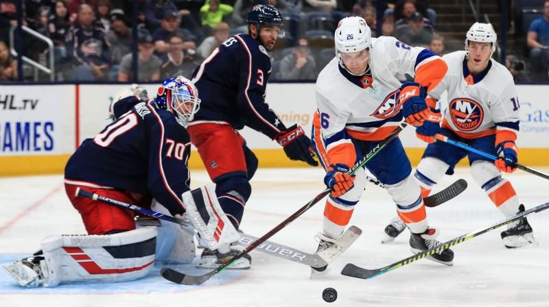 """Jūns Karpisalo (nr. 70) pret Ņujorkas """"Islanders"""" atvairīja 31 no 34 metieniem. Foto: USA TODAY/Scanpix"""