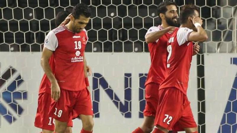 """""""Persepolis"""" futbolisti priecājas par vārtu guvumu. Foto: AFP/Scanpix"""